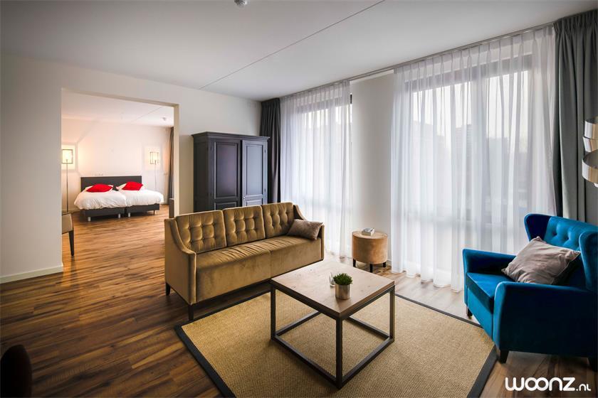 De-Statenhof-appartement-stoel-slaapkamer